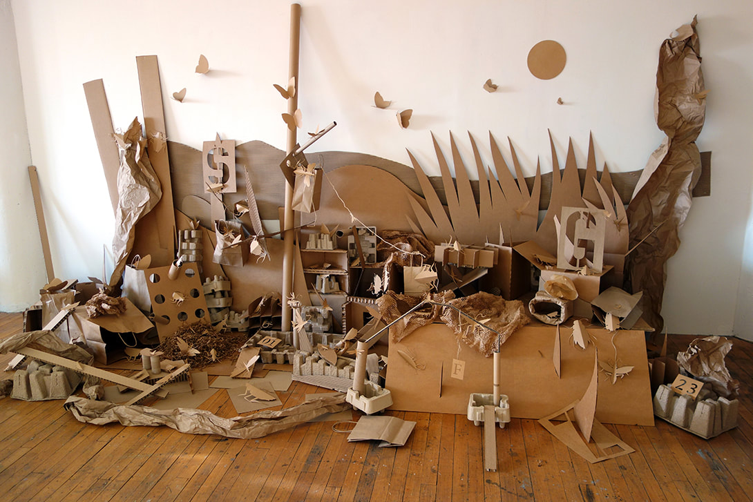 Cardboard Universe with paper insects